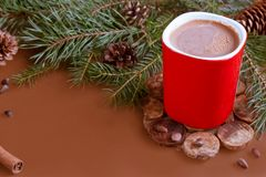 Christmas traditional hot drink cocoa in red cup, fir branches and cones on the dark wooden background copy space Royalty Free Stock Photography