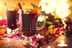 Christmas traditional mulled wine. On holiday decorated table stock photography