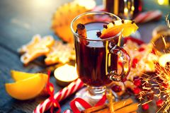 Christmas traditional mulled wine. On holiday decorated table Stock Photo