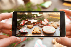 Christmas traditional treat photography on phone Stock Photos