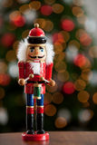 Christmas: Traditional Wooden Nutcracker With Tree Behind Stock Photos