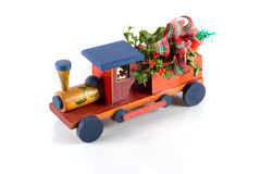Christmas train alpha. Wooden Christmas train with ribbon stock image