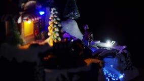 Christmas train and Christmas lights, snow town stock video