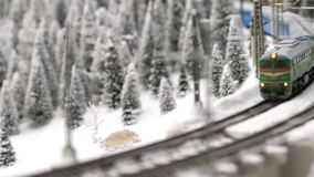 Christmas train goes through fantastic winter forest in slow motion. 3840x2160. 4k stock footage