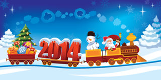 Christmas train. New Year 2014 and Santa Claus in a toy train with gifts, snowman and christmas tree Stock Image