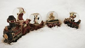 Christmas train. A christmas snow globe train in the freshly fallen snow Stock Image