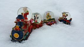 Christmas train. A snow globe of a Christmas train sitting in the snow Royalty Free Stock Photo