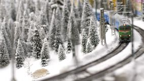 Christmas train toy goes through fantastic winter forest in slow motion. 3840x2160. 4k stock footage
