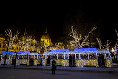 Christmas tram in Budapest, with the Parliament in Stock Photo