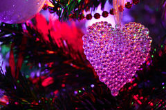 Christmas transparent heart. Nice crystal toy heart on the chrismas tree Stock Images