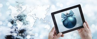 Christmas travel and online shopping concept, hands showing digi stock illustration