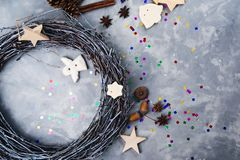 Christmas treat decorating. Creative christmas diy. Handmade xmas wreath. Home leisure, trinkets and details for holiday. Decorations on grey concrete royalty free stock image