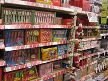 Christmas Treats. Store shelf displaying christmas treats. Various candy canes on display Stock Images