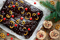 Christmas treats for dessert - festive chocolate cake and cupcak. Es top view Royalty Free Stock Photography