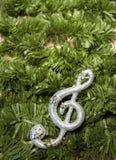 Christmas treble clef on tinsel Stock Image