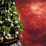 Christmas tree. With decorations on grungy background Royalty Free Stock Image