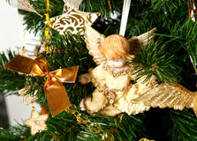 Christmas tree. Decorated Christmas tree. Artifical. Green and golden colors Stock Photo