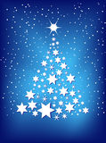 Christmas tree. On a blue background Stock Photos