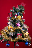 Christmas Tree. With baubles and star ornaments and gifts Stock Photography