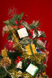 Christmas Tree. With baubles and star ornaments and gifts Stock Photos