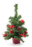 Christmas tree. A small decorated Christmas tree on white background Stock Photo