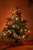 Christmas tree. With colorful lights stock images