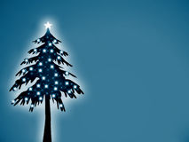 Christmas tree. With shinning star and ornaments, on blue background Stock Photography