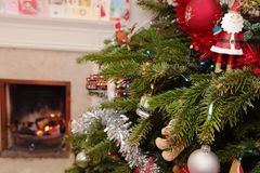 Christmas Tree. A Christmas tree with an open fire in the background Stock Image