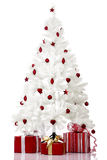 Christmas Tree. Christmas white tree and gifts over a white background Stock Images