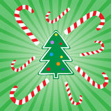 Christmas tree. And candies on the striped background Stock Image