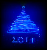 Christmas tree. Vector illustration of blue Abstract Christmas tree on the black background. 2011 Royalty Free Stock Images