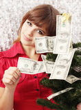 Christmas tree. Girl holds Christmas tree decorated with money Stock Photo
