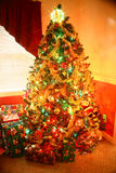 Christmas Tree. With Lights and Gifts Royalty Free Stock Photo