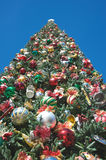 Christmas tree. Seen from bellow with many adornments Royalty Free Stock Photography