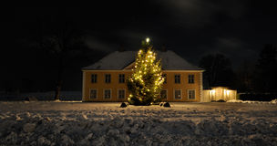 Christmas tree. One winter evening at a house Royalty Free Stock Photography