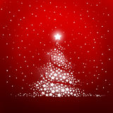 Christmas tree. On a red bakground Stock Photos