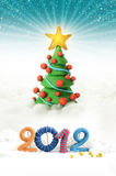 Christmas tree 2012. Illustrated Christmas tree with snowy background and a colorful 2012 in the foreground Stock Photo