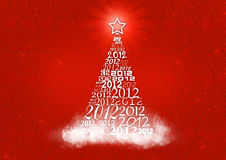 Christmas tree with 2012 texts. Christmas tree with many 2012 logo in red background Royalty Free Stock Photo