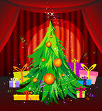 Christmas tree. With gifts on the theater stage Stock Photos