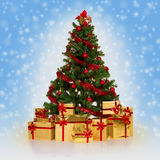 Christmas tree. Christmas fir tree and gifts over blue background Stock Photo