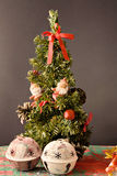 Christmas tree. Little Christmas tree with two little Santa Klaus standing on it Royalty Free Stock Photos