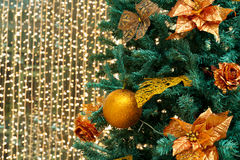 Christmas tree. Fragment of christmas tree with gilt ball and flowers stock photo