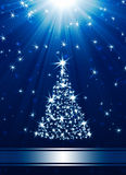 Christmas tree. Made of stars against blue background with place for text Stock Photo