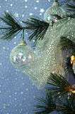 Christmas Tree. Iridescent ornaments, silver beads and glittery silver netting adorn a lighted Christmas tree stock photo
