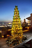 Christmas tree. Built from empty water bottles and Istanbul cityscape in the background royalty free stock image
