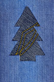 Christmas tree. Cut out of denim Stock Images