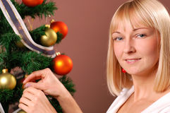 Christmas Tree. Happy young woman decorating Christmas Tree Stock Photography