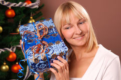 Christmas Tree. Happy young woman decorating Christmas Tree Royalty Free Stock Images