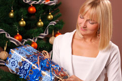 Christmas Tree. Happy young woman decorating Christmas Tree Stock Photo