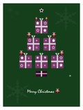 Christmas tree. Christmas greeting card with shapes of Christmas tree which is created from gift boxes Stock Image